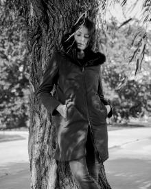 Model by Willow Tree wearing Herno coat with hood and fur