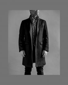 male model wearing herno system coat.